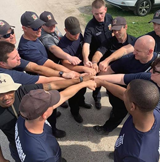 firefighter group huddle