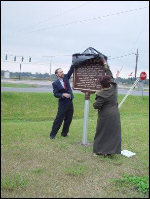 Carolyn Brown uncovering the historical marker
